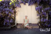 senior portrait with wisteria